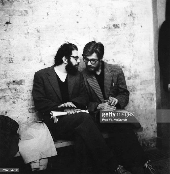 American poet Allen Ginsberg talks with his longtime companion fellow poet Peter Orlovsky in the lobby of the Living Theatre at a fundraising event...