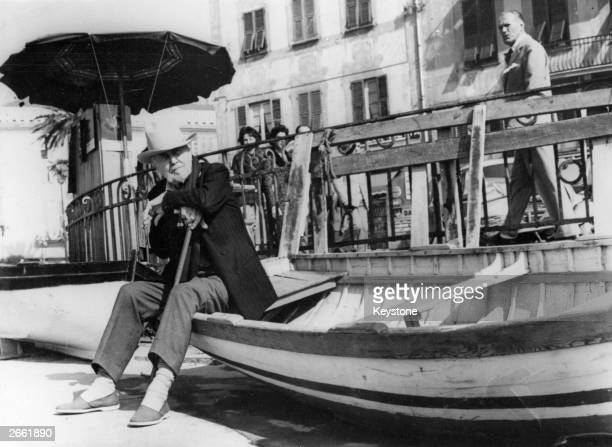 American poet and critic Ezra Loomis Pound on the seafront in Rapallo Italy not long after being released from an American asylum where he spent...