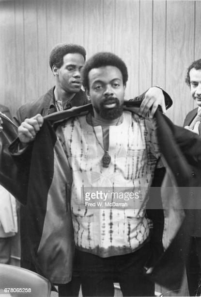 American poet and playwright Amiri Baraka and unidentified others attend a press conference about a planned apartment complex Kawaida Towers Newark...