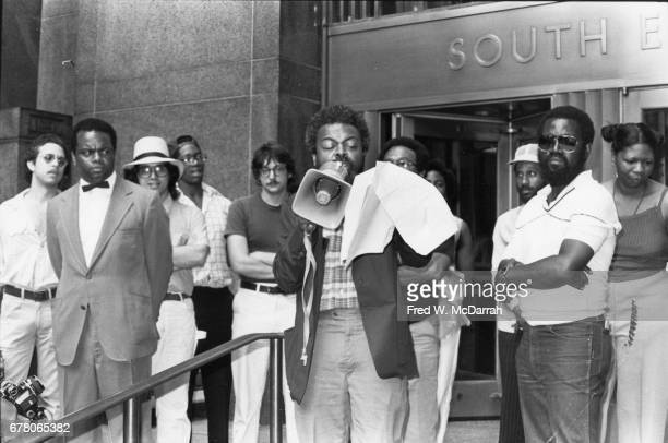 American poet and playwright Amiri Baraka speaks into a loudspeaker at a protest outside New York County Criminal Court building New York New York...
