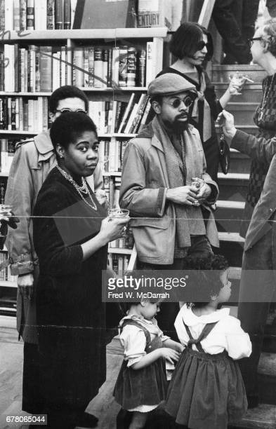American poet and playwright LeRoi Jones and his wife fellow poet and author Hettie Cohen Jones speak with unidentified others at a party held in the...