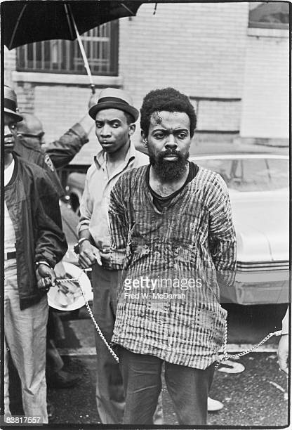 American poet and playwright LeRoi Jones leaves a police station bloodied and in chains after being arrested during a riot Newark New Jersey July 14...