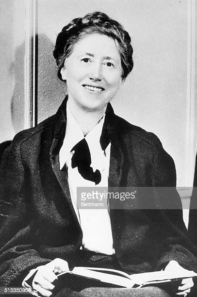 American poet Marianne Moore holding an open book