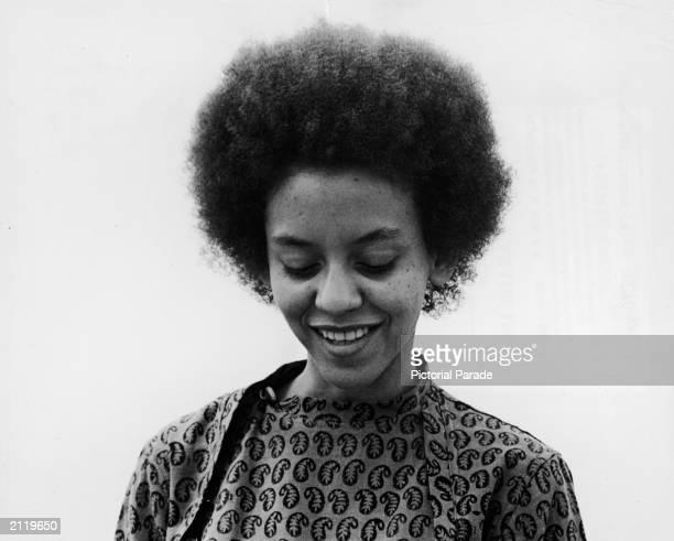 American poet Yolanda Cornelia 'Nikki' Giovanni looks down circa 1968