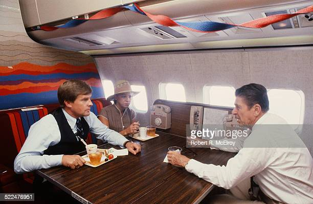 American politian and US President Ronald Reagan talking to one of his aides on board Air Force One during his reelection campaign Texas June 1 1984