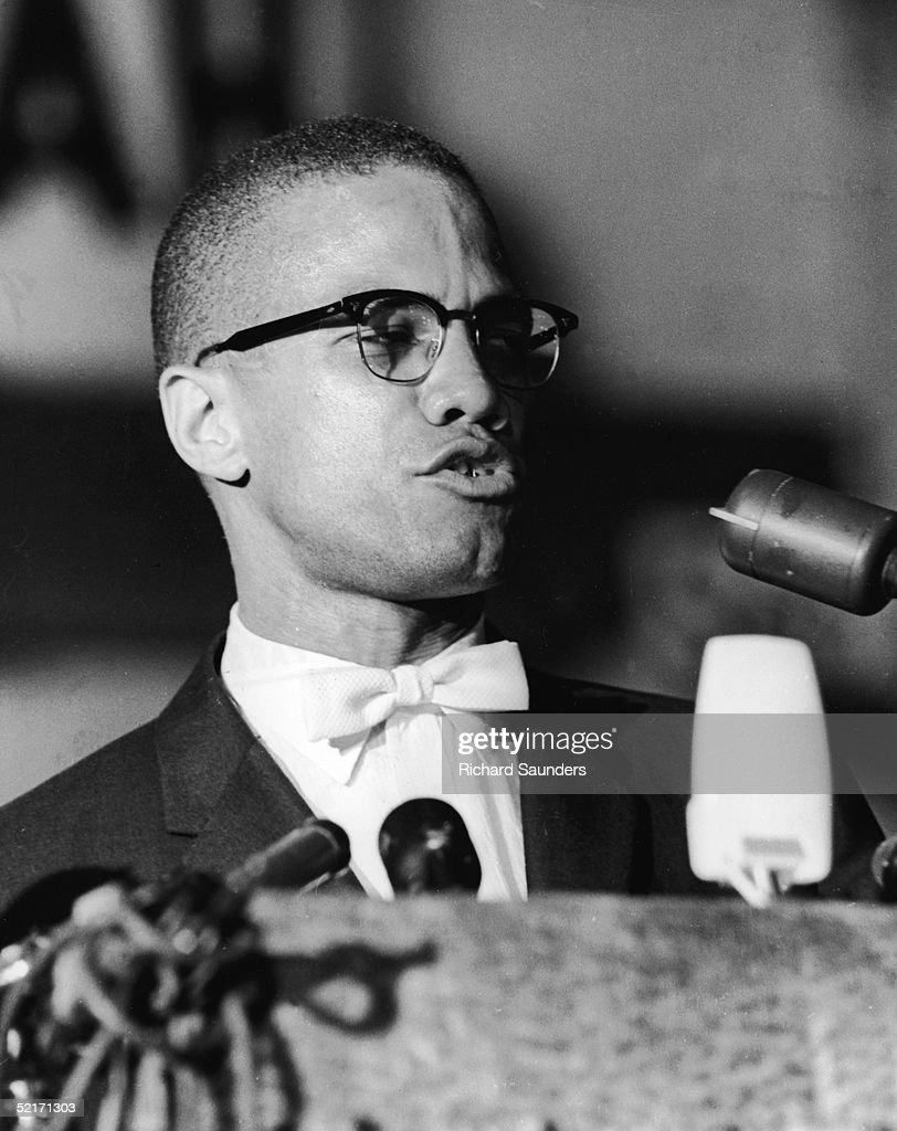 American political activist and radical civil rights leader Malcolm X speaks from a podium during a rally of AfricanAmerican Muslims Washington DC...
