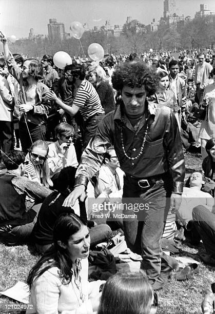 American political and social activist Abbie Hoffman walks among the attendees at the 'BeIn' in Central Park New York New York April 14 1968