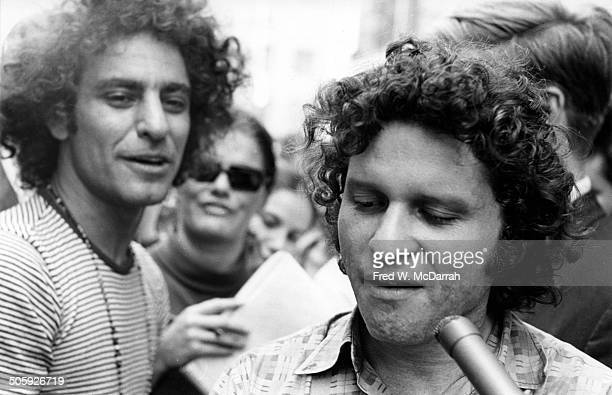 American political and social activist Paul Krassner talks to a journalist as Abbie Hoffman listens during a 'Yippie' event on St Marks Place New...