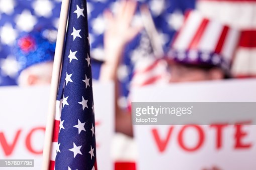 American political rally with VOTE signs