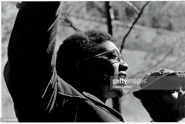 American political and social activist and Black Panther Party member Fred Hampton raises his arms at the 'Days of Rage' rally Chicago Illinois...