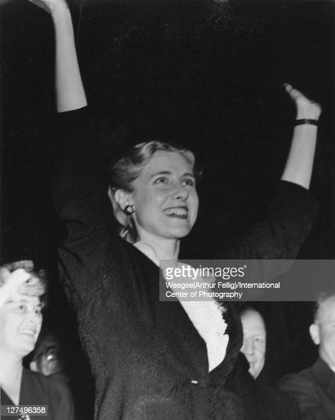 American politician and author Congresswoman Clare Boothe Luce raises her arms and smiles as she attends a New Jersey State Woman's Republican Club...