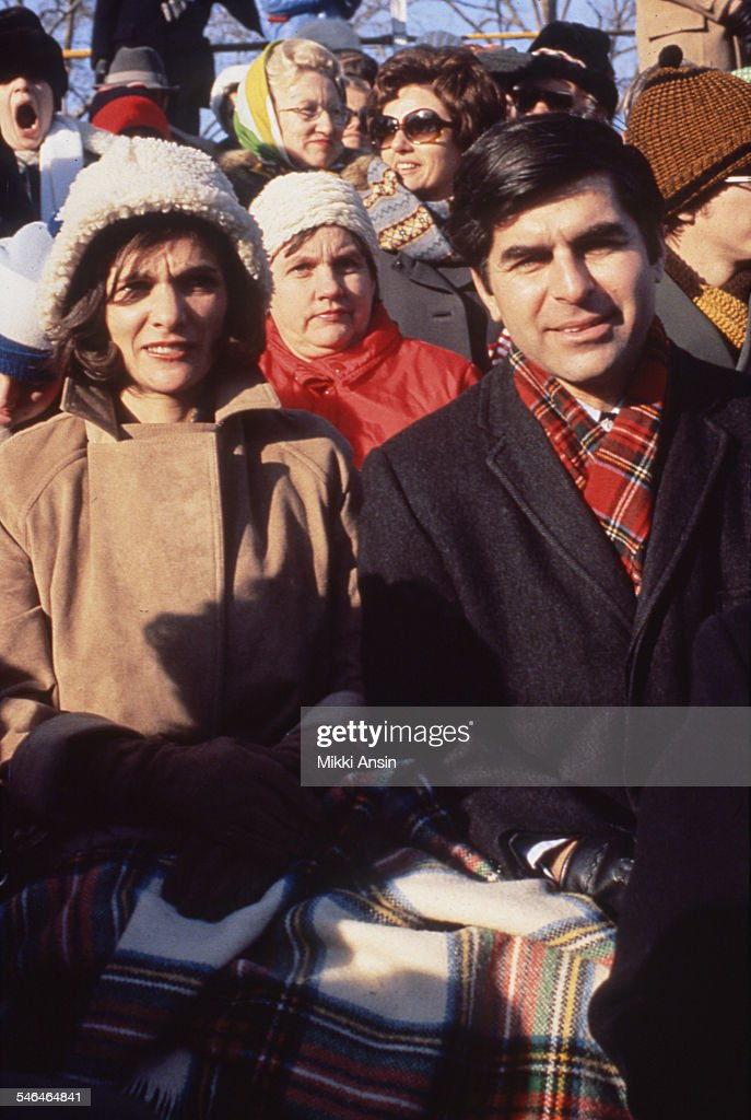 American politician and Governor of Massachusetts <a gi-track='captionPersonalityLinkClicked' href=/galleries/search?phrase=Michael+Dukakis&family=editorial&specificpeople=210699 ng-click='$event.stopPropagation()'>Michael Dukakis</a> and his wife, Kitty, attend President Jimmy Carter's Inaugural Parade, Washington DC, January 20, 1977.