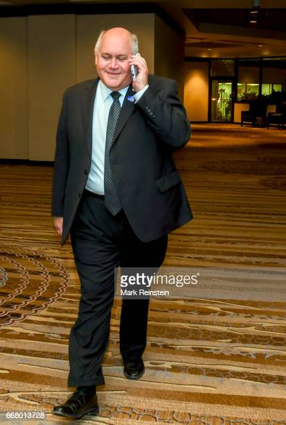 American politician and Kansas State Treasurer Ron Estes talks on his smartphone as he attends a celebration in honor of his Congressional special...