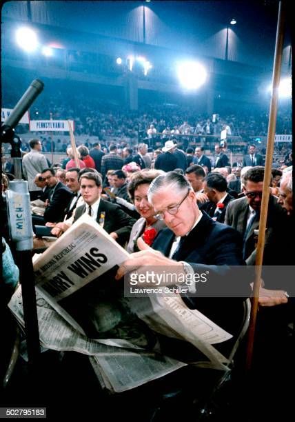 American politician and Michigan Governor George Romney reads a newspaper during the 1964 Republican National Convention at the Cow Palace San...
