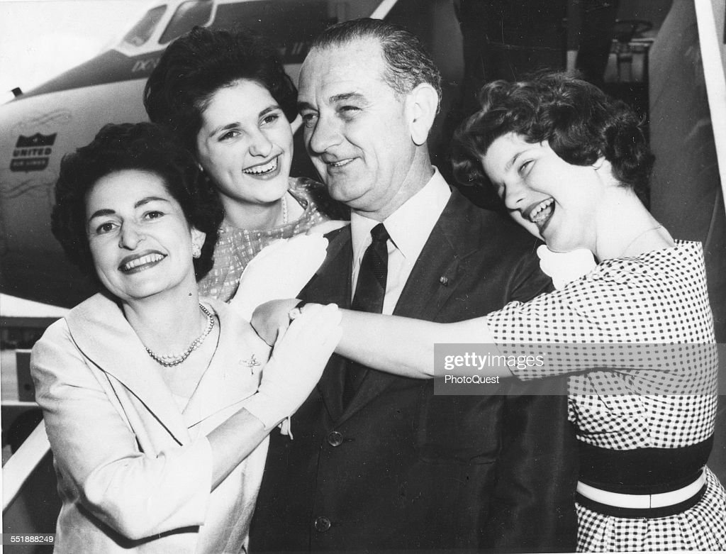 American politician and Senator Lyndon B Johnson (1908 - 1973) poses with his family at an unspecified airfield before the Democratic National Convention where he would receive the party nomination for Vice President, Los Angeles, California, July 7, 1960. Pictured are, from left, wife Lady Bird (1912 - 2007), daughter Lynda Byrd, LBJ, and daughter Luci Baines.
