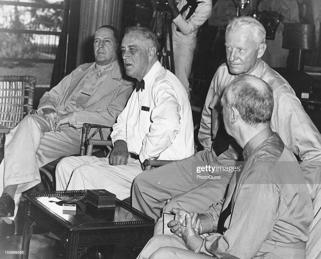 American politician and US President Franklin D. Roosevelt (1882 - 1945) (second left) meets with military leaders, Pearl Harbor, Hawaii, July 26, 1944. Discussing the drive to liberate the Philippines, with the Presdident are, from left, General Douglas MacArthur, Admiral <a gi-track='captionPersonalityLinkClicked' href=/galleries/search?phrase=Chester+Nimitz&family=editorial&specificpeople=93219 ng-click='$event.stopPropagation()'>Chester Nimitz</a>, and Admiral William Leahy.