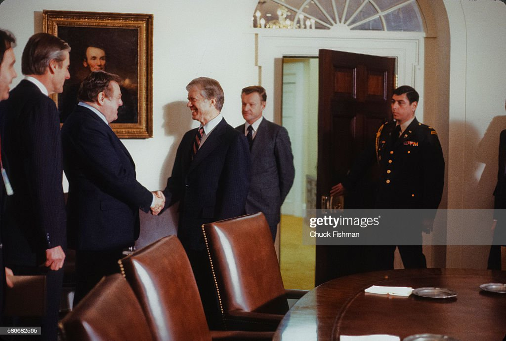 American politician and US President Jimmy Carter smiles as he shakes hands with German politician and statesman Franz Josef Strauss 1915 1988 during...