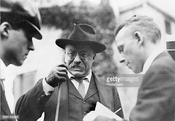 American politician and US President Theodore Roosevelt clenches his teeth as he makes a point during an interview with unidentified journalists mid...