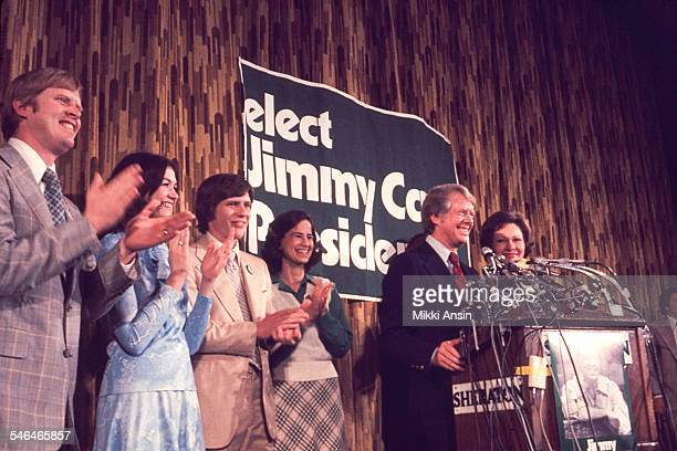 American politician and US Presidential candidate Jimmy Carter and his wife Rosalynn Carter smile after his victory in the Pennsylvania Primary...