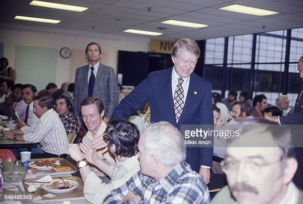 American politician and US Presidential candidate Jimmy Carter greets people in a cafeteria during a campaign event Boston Massachusetts 1976