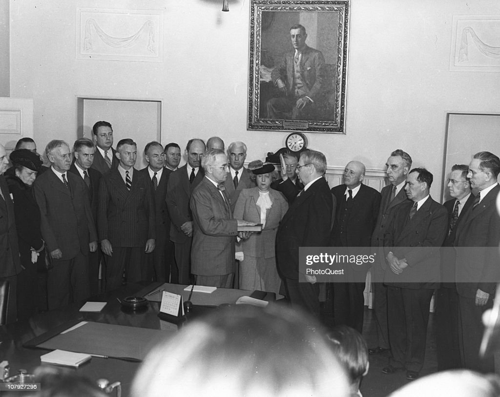 American politician Harry S. Truman (1884 - 1972) (center left) is sworn in as President of the United States in the White House, Washington DC, August 12, 1945. Truman took the oath following the death of President Franklin Delano Roosevelt; the ceremony is witnessed by his wife <a gi-track='captionPersonalityLinkClicked' href=/galleries/search?phrase=Bess+Truman&family=editorial&specificpeople=93132 ng-click='$event.stopPropagation()'>Bess Truman</a> (1885 - 1982) and various members of the former president's cabinet.