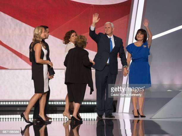 American politician Indiana Governor and vicepresidential candidate Mike Pence and wife Karen wave from the stage as family members walk off during...