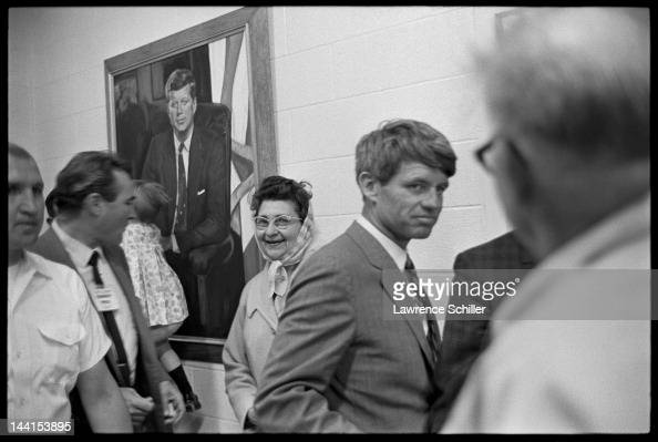 American politician Robert F Kennedy pauses near a portrait of his brother assassinated President John F Kennedy during a campaign stop South Dakota...