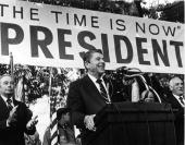 American politician Ronald Reagan smiles as he speaks on his presidential campaign in front of a large banner 1979 Pennsylvania governor William...