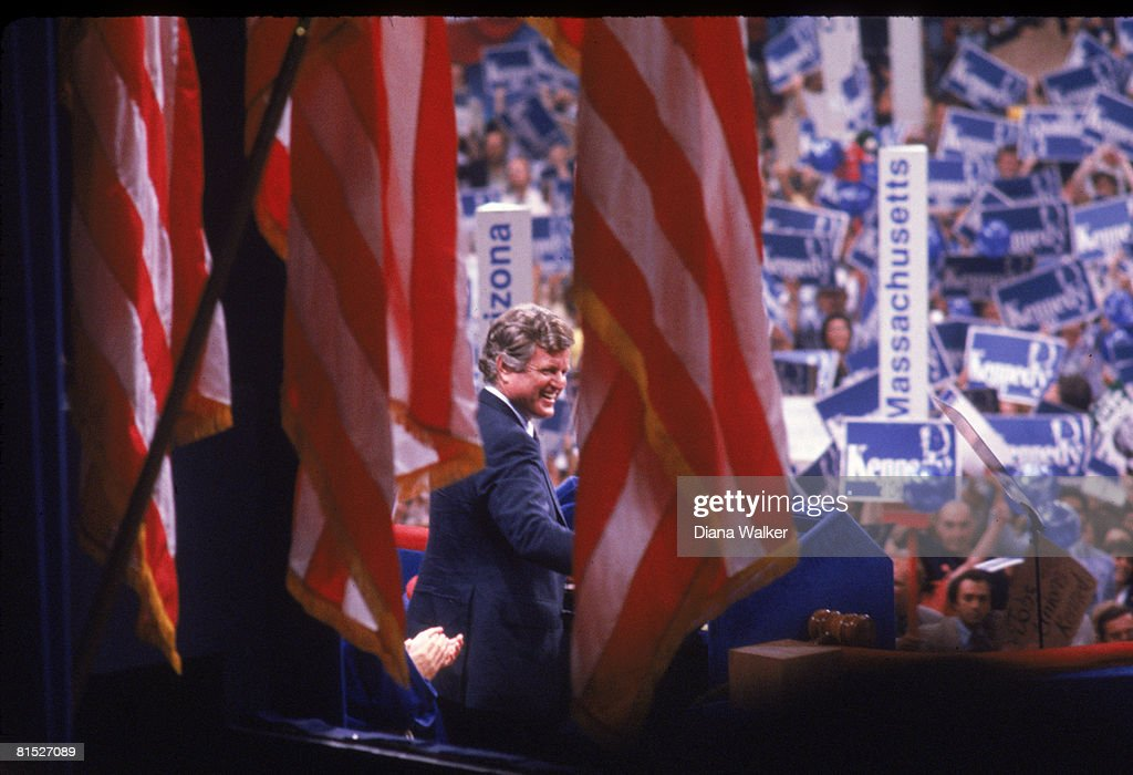 American politician Senator Edward Kennedy is framed between American flags as he delivers a speech at the Democratic National Convention in Madison Square Garden, New York, New York, August 12, 1980.