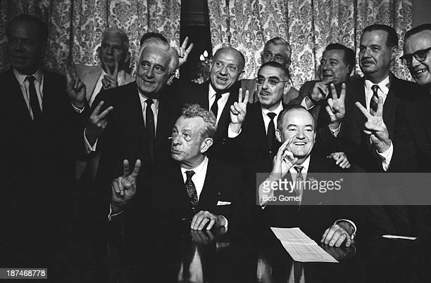 American politician Senators Everett Dirksen and Hubert Humphrey pose with their fellow senators after passing a vote for cloture on the Civil Rights...