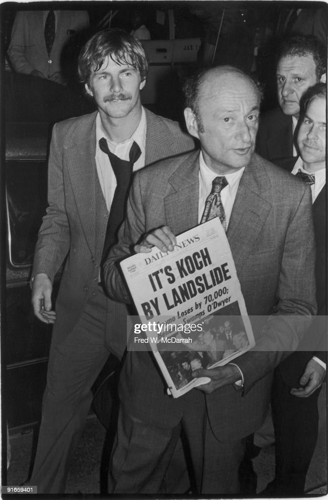 American politician soon-to-be three-term mayor of New York City Ed Koch holds up a copy of New York Daily News, which sports the headline 'It's Koch by a Landslide,' after he won the mayoral election, New York, New York, November 8, 1977.