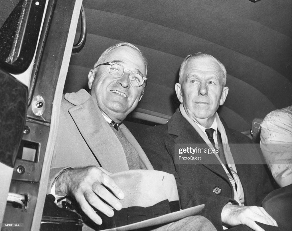 American politician US President Harry S. Truman (1884 - 1972) (left) smiles as he sits in a car with Secretary of State George C. Marshall (1880 - 1959), November 22, 1948.