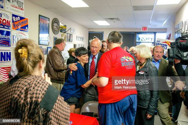 American politician US Senator Pat Roberts hugs a supporter at his campaign headquarters Overland Park Kansas October 12 2014 Visible at right is his...