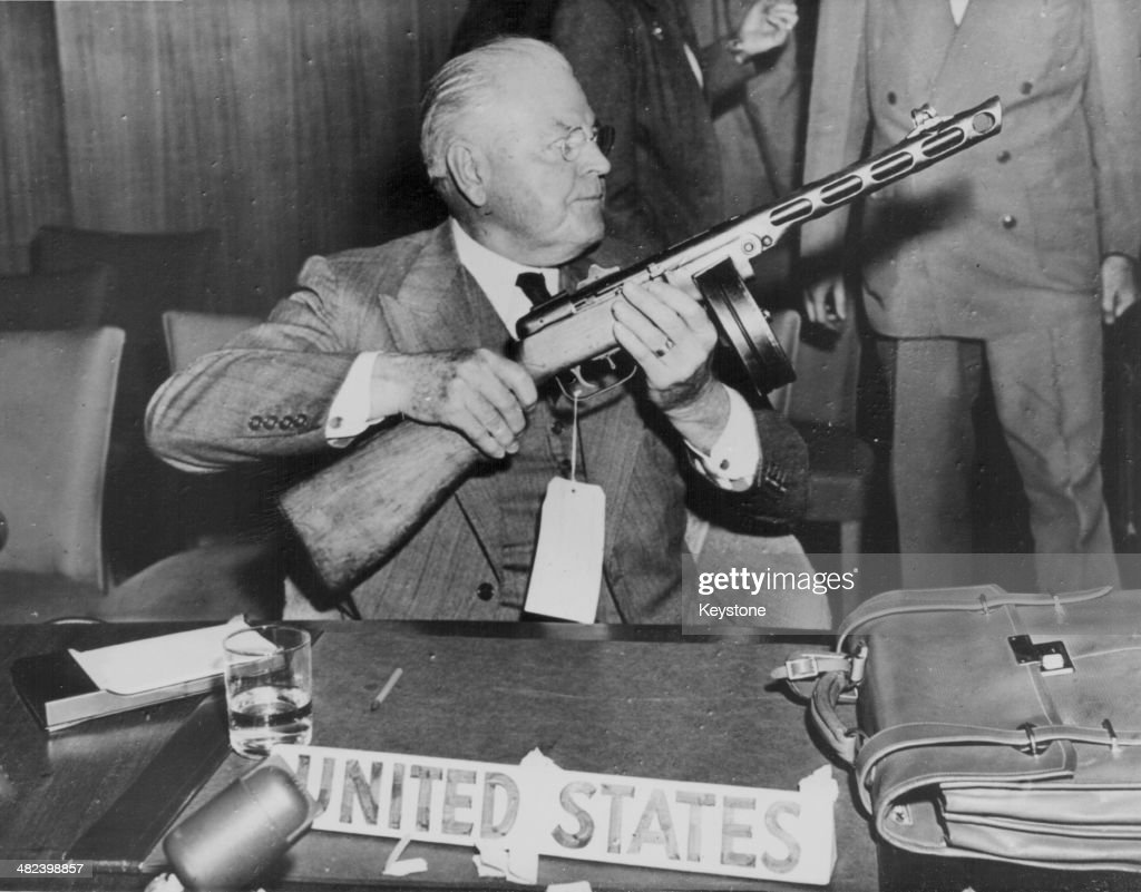 American Politician Warren Austin displaying a Russian submachine gun at the United Nations Security Council at Lake Success New York September 21st...