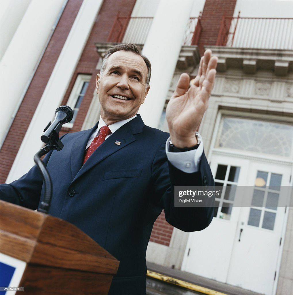 American Politician Waving from a Podium