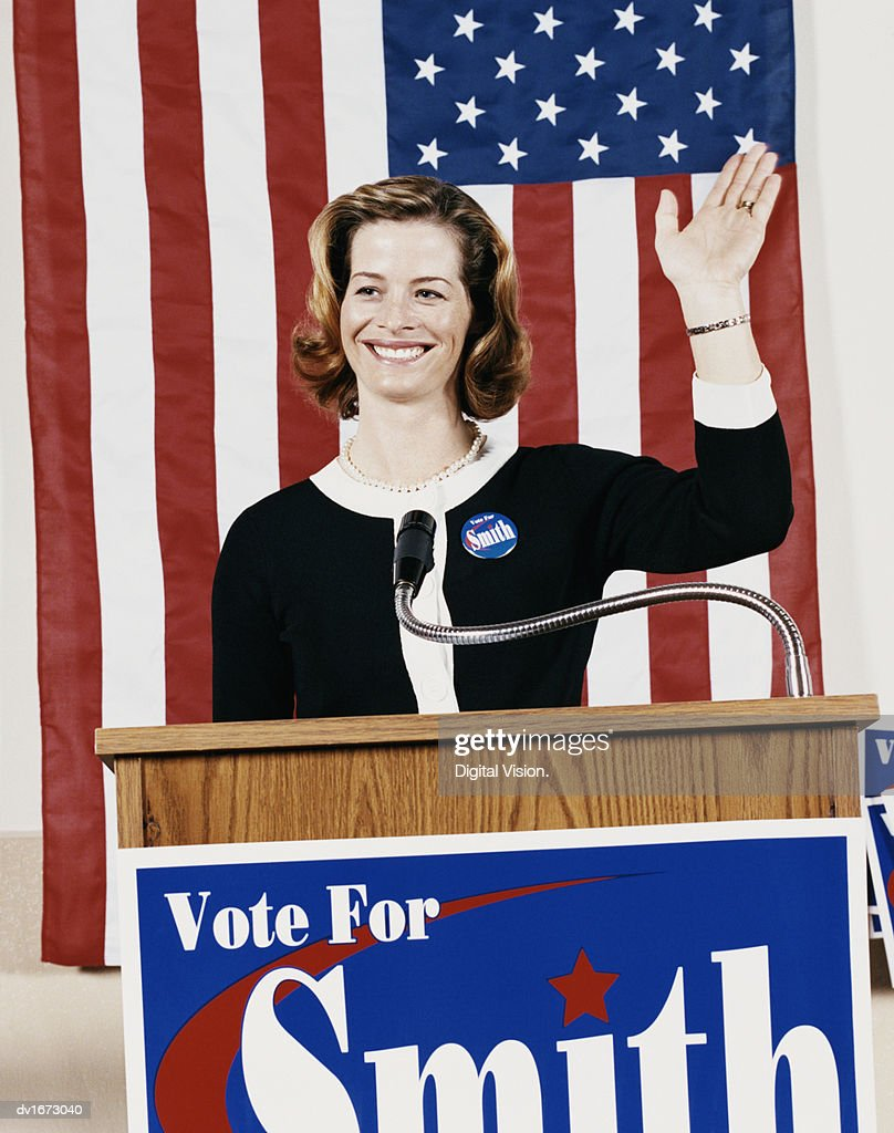 American Politician Waving from a Podium : Stock Photo