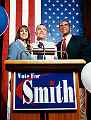 American Politicians Standing Behind a Podium During a Political Rally
