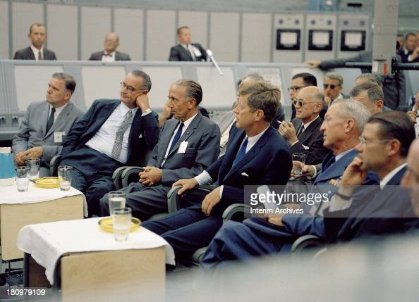 American politicians US President John F Kennedy and Vice President Lyndon B Johnson listen to a presentation during a tour of Cape Canaveral Florida...