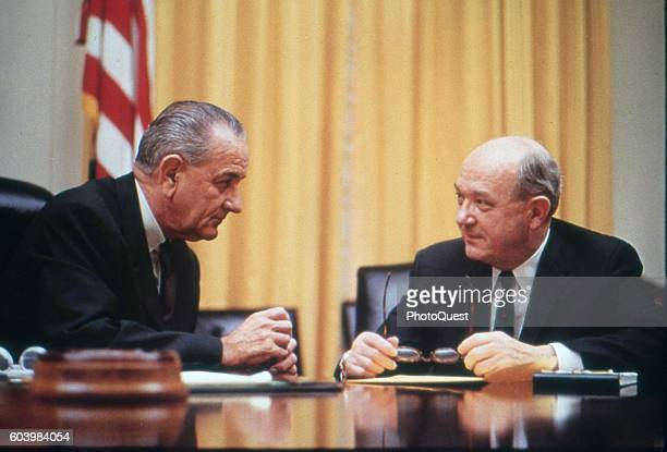 American politicians US President Lyndon B Johnson confers with Secretary of Defense Dean Rusk at a conference table in the White House Washington DC...