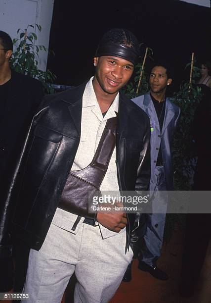American pop and rb musician Usher arrives at the 5th Annual Blockbuster Entertainment Awards ceremony at the Shrine Auditorium Los Angeles...