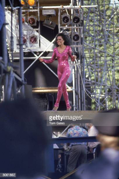 American pop and RB singer Diana Ross performs on stage wearing a violet sequined jumpsuit during her Central Park concert New York City July 22 1983