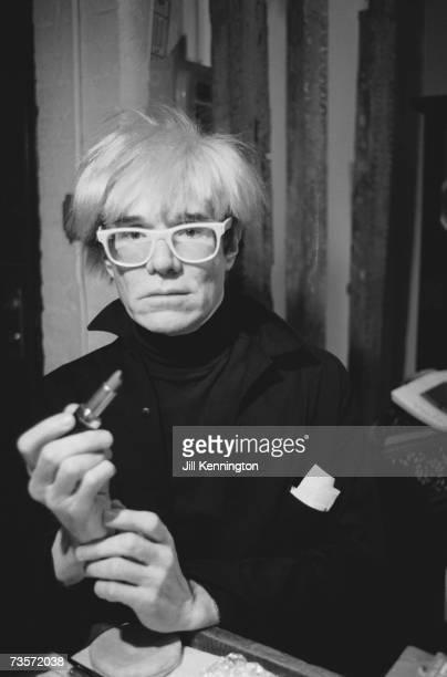 American pop artist Andy Warhol holding a lipstick circa 1985