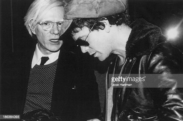 American Pop artist Andy Warhol speaks with singer and musician Lou Reed durin an event in the Studio 54 nightclub New York New York 1977