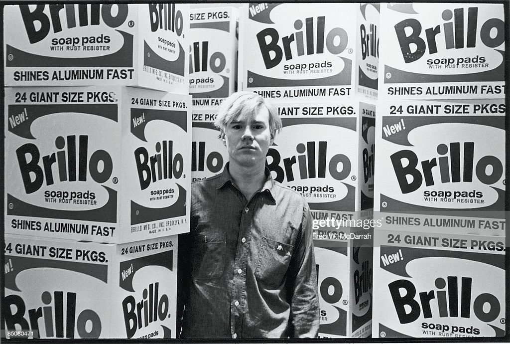 American pop artist <a gi-track='captionPersonalityLinkClicked' href=/galleries/search?phrase=Andy+Warhol&family=editorial&specificpeople=123830 ng-click='$event.stopPropagation()'>Andy Warhol</a> (1928 - 1987) stands amid his towering Brillo box sculptures in the Stable Gallery (33 East 74th Street), New York, New York, April 21, 1964.