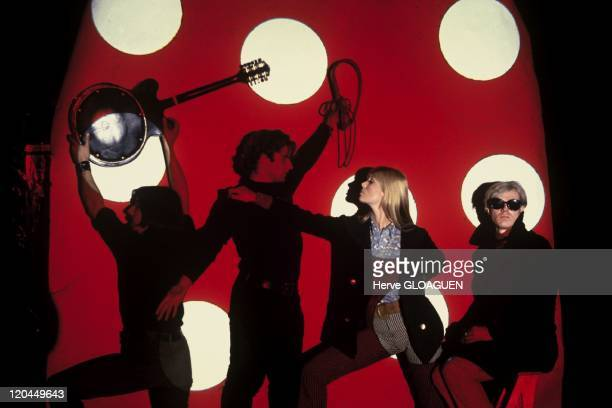 American pop artist Andy Warhol with his associate Gerard Malanga and members of the Velvet Underground New York City circa 1966 Left to right John...