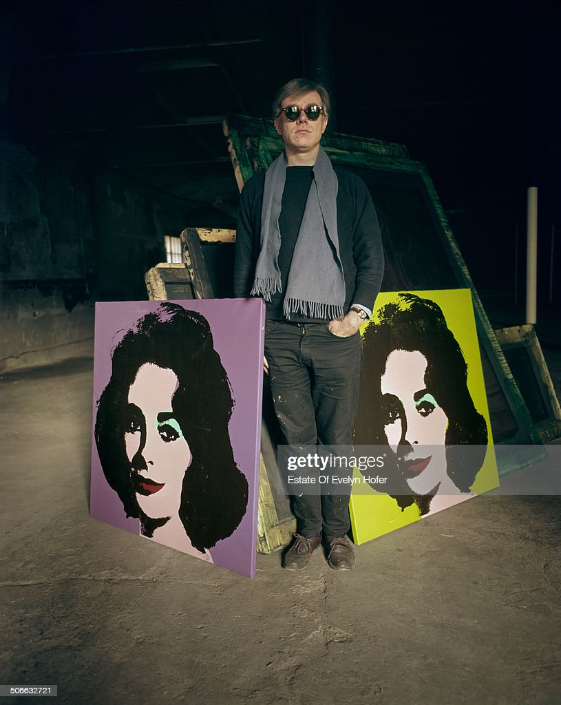 American pop artist <a gi-track='captionPersonalityLinkClicked' href=/galleries/search?phrase=Andy+Warhol&family=editorial&specificpeople=123830 ng-click='$event.stopPropagation()'>Andy Warhol</a> (1928 - 1987) with two prints of actress Elizabeth Taylor, New York, 1964.