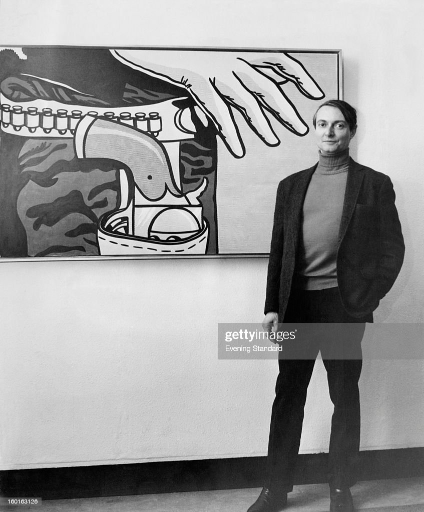 American pop artist Roy Lichtenstein (1923 - 1997) standing in front of his 1963 work 'Fastest Gun' at the Tate Gallery, London, 4th January 1968.