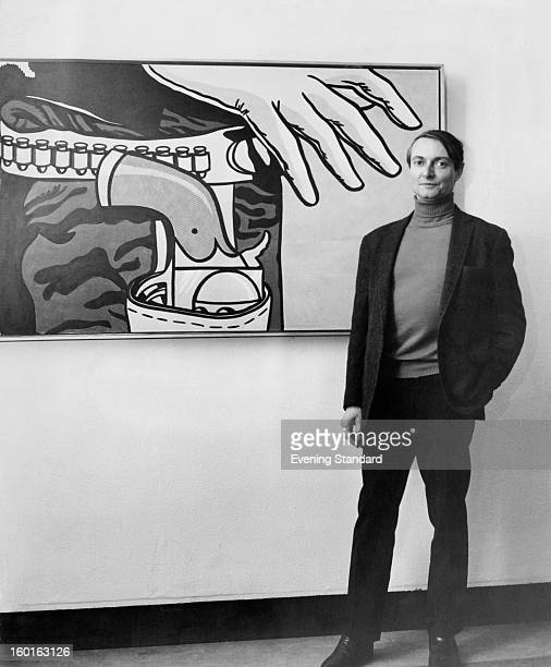 American pop artist Roy Lichtenstein standing in front of his 1963 work 'Fastest Gun' at the Tate Gallery London 4th January 1968