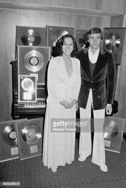 American pop duo The Carpenters Karen Carpenter and her brother Richard with awards for sales of their albums 22nd February 1974