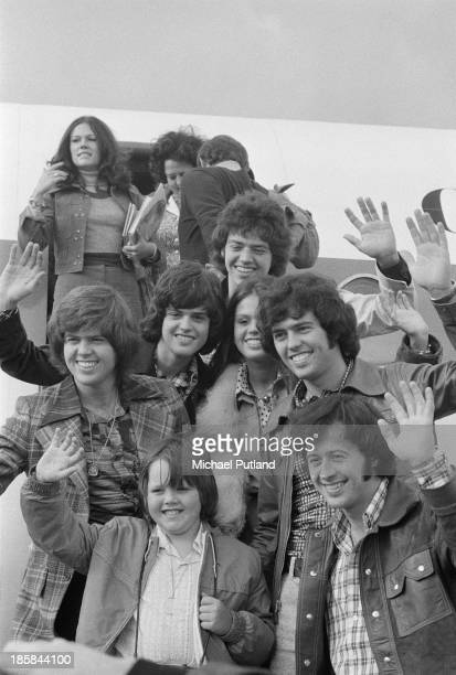 American pop group The Osmonds arrive at Glasgow Airport for a date at the Apollo on the British leg of their European tour 25th October 1973...